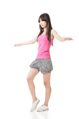Young asian woman walking on imaginary rope
