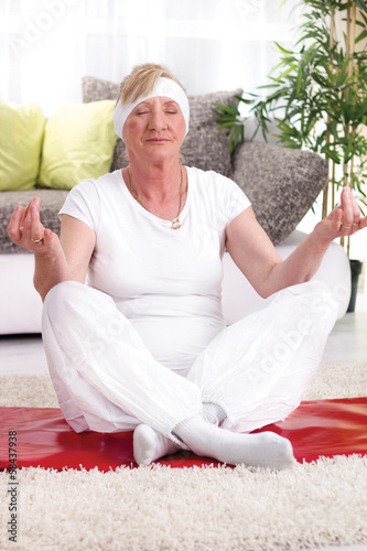 smiling senior woman exercise yoga at home