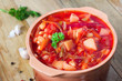 Russian borscht on rustic table