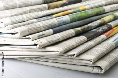 Pile of Various newspapers over white background. - 58439349