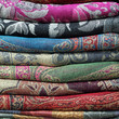 pile of pashmina shawls as background