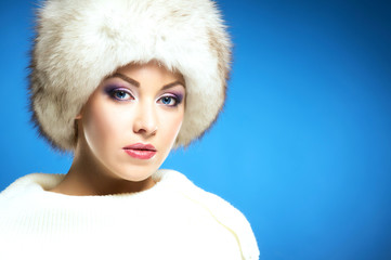 Portrait of a young and beautiful woman in a winter hat