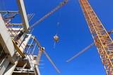Fototapety chantier de construction grues et poutrelles béton