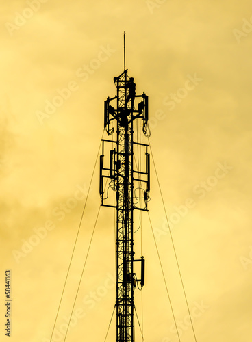 Two Technicians Working On A Telecommunication Tower silhouette