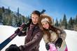 Happy couple on ski