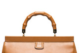 Closeup of light brown leather handbag handle