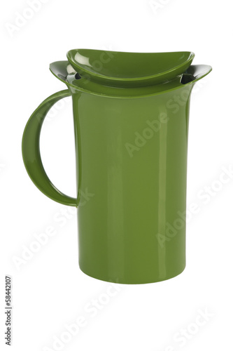 Green plastic mug on white background