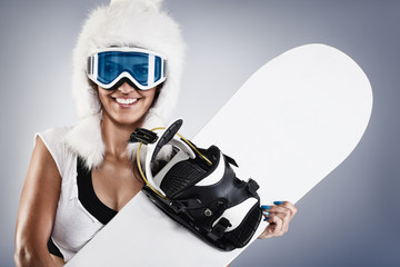 Beautiful young snowboarder