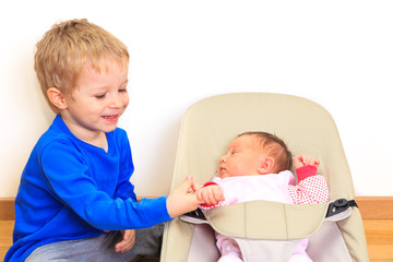 Brother enjoying time together with newborn sister