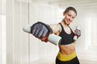 Happy woman working out with dumbbells