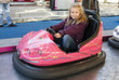 girl driving a bumper car