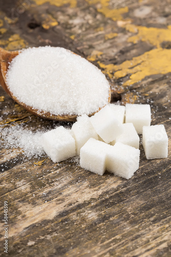 Sugar on wooden background