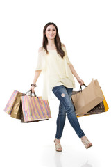 Attractive asian woman holding shopping bags