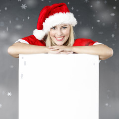 Woman shows voucher for christmas