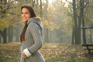smiling woman in autumn park