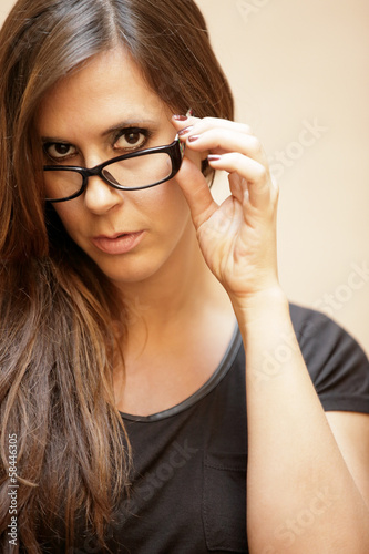 Stock image of a woman removing her glasses