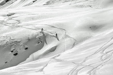Couple skiers in the big mountains