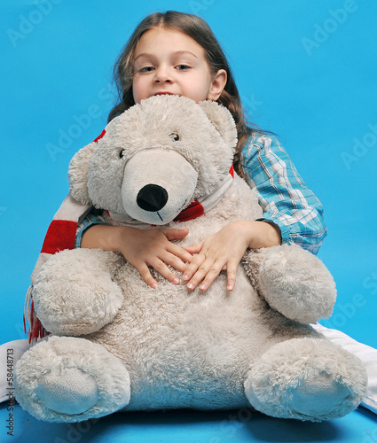 Caucasian little girl with a polar bear
