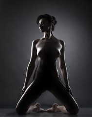 Studio shot of seductive naked oiled model