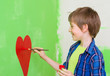 boy painting on the wall
