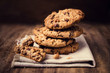Chocolate cookies on white linen napkin on wooden table. Chocola