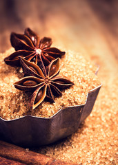 Brown sugar and Star Anise in a baking tray on wooden table, sti