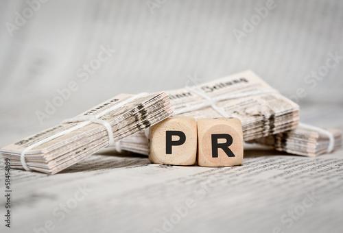 Leinwanddruck Bild PR - Zeitungsstapel