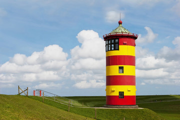 Historical Lighthouse at the North Sea in Germany`s Pilsum.
