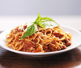 spaghetti dinner with meat sauce and basil