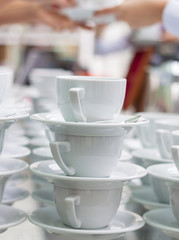 Lots of coffee cups with hands on background