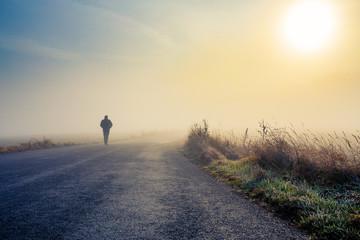 men silhouette in the fog