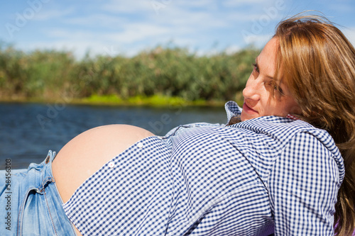 Portrait of a young content pregnan woman