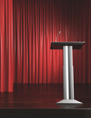 podium and red curtain