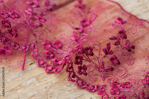 Purple lace on wooden background