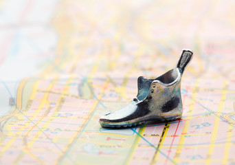 road map with statuette shoes. with selective focus
