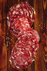 french Salami on a wood with Fennel
