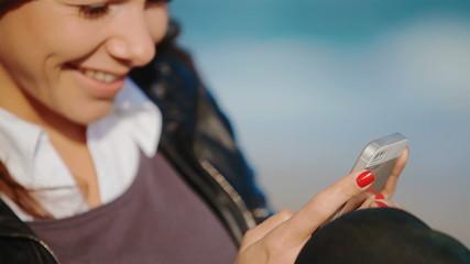 happy girl enjoys a smartphone