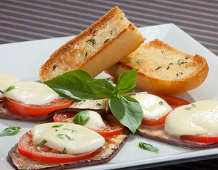 Baked aubergine w tomatoes and mozzarella
