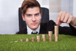 Businessman Arranging Coins