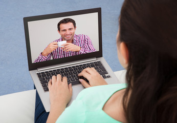Woman Video Chatting On Laptop