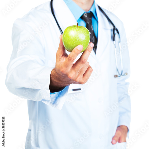 Doctor's hand holding a fresh green apple close-up on white