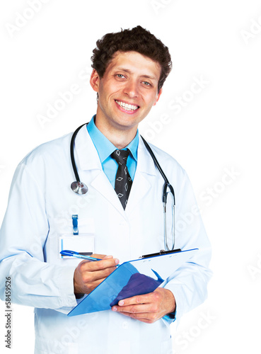 Portrait of smiling young male doctor writing on a patient's med