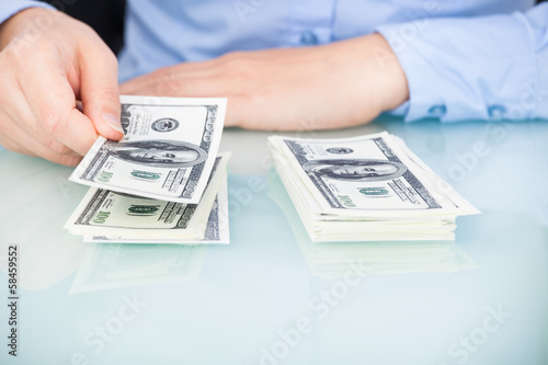 Businesswoman Counting Bank Note