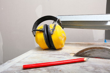 Work tools saw cutter to cut tile, protective headphones