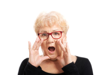 An old lady expresses shock/ surprise.