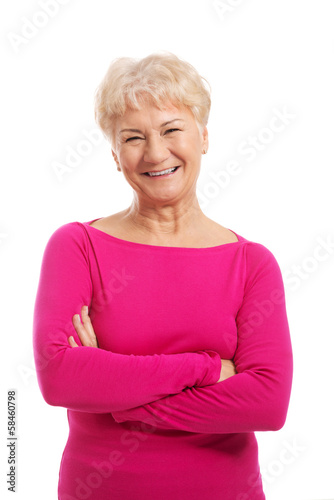 An old lady's portrait in pink casual clothes.