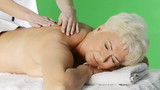 Senior woman heaving massage at spa salon