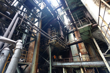 Interior of steel mill with pipes and valves