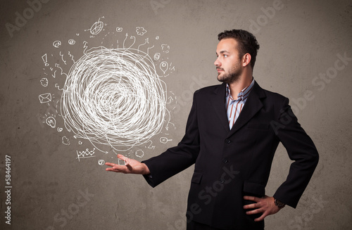 Chaos concept in the hand of a businessman