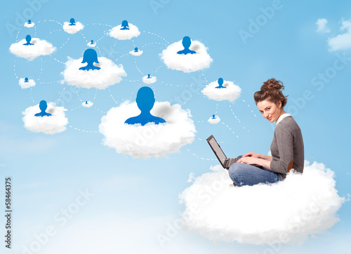 Leinwandbild Motiv Young woman sitting in cloud with laptop